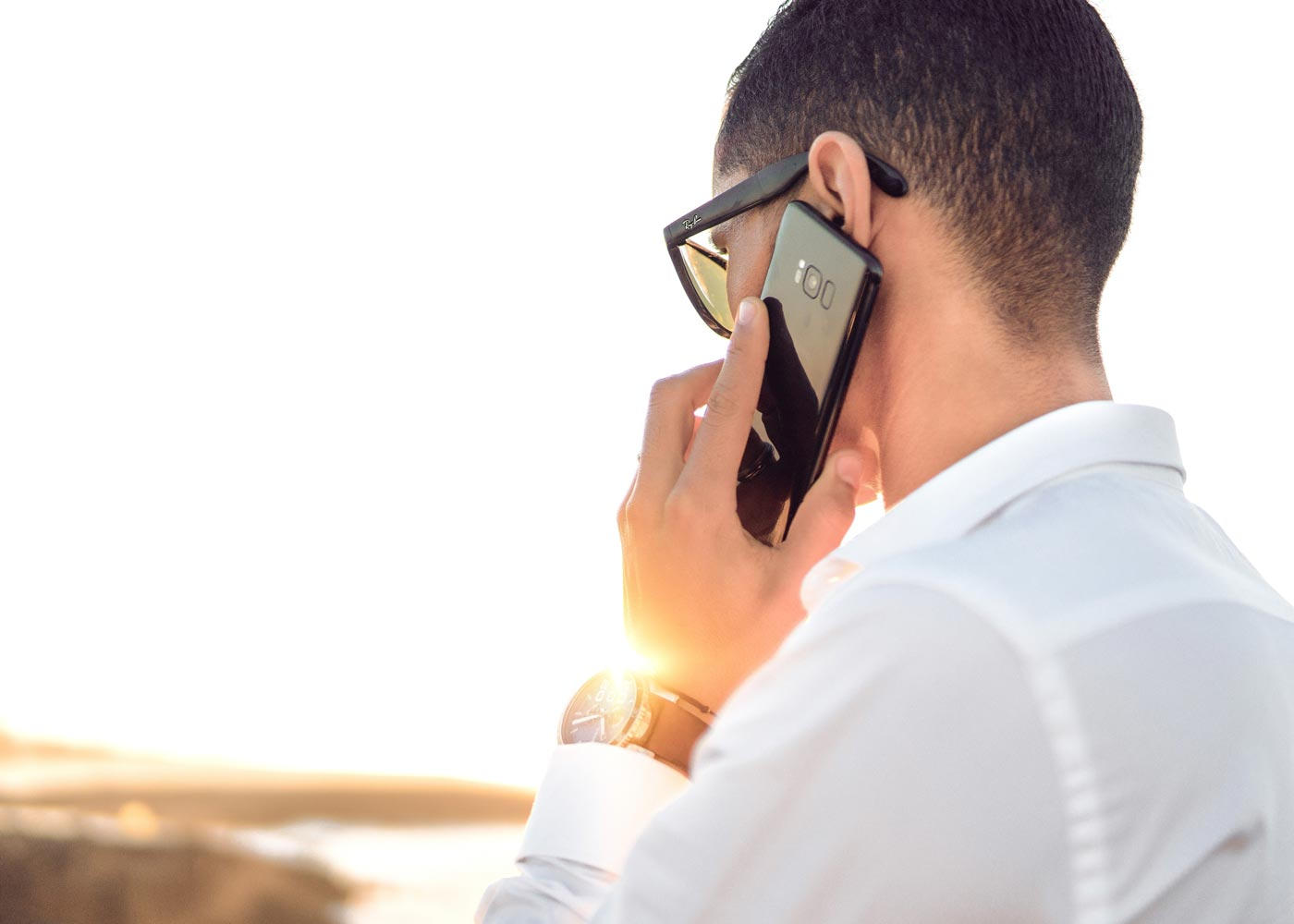 Person making a phone call with a mobile phone.